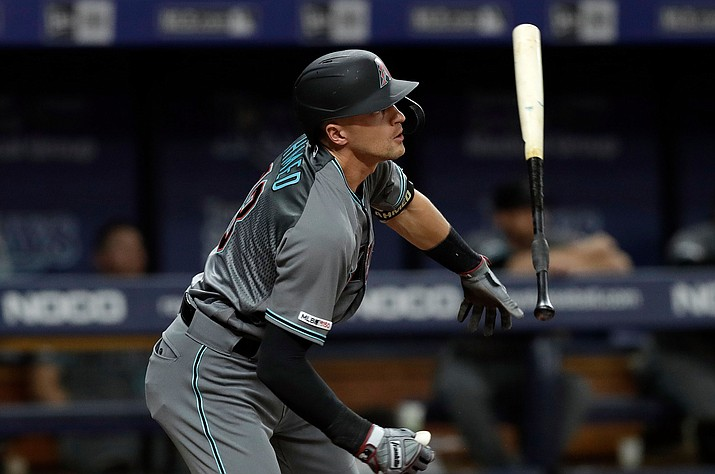 Arizona Diamondbacks' Nick Ahmed flips his bat after his RBI-double off Tampa Bay Rays relief pitcher Jalen Beeks during the fourth inning on Tuesday, May 7, 2019, in St. Petersburg, Fla. Arizona's Adam Jones scored. (Chris O'Meara/AP)