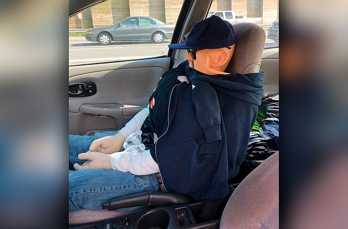 Suffolk County police say something about the front-seat passenger in a Saturn sedan raised Highway Patrol Officer Andrew Spina's suspicions Monday on the Long Island Expressway in Dix Hills. (Suffolk County Police Department)