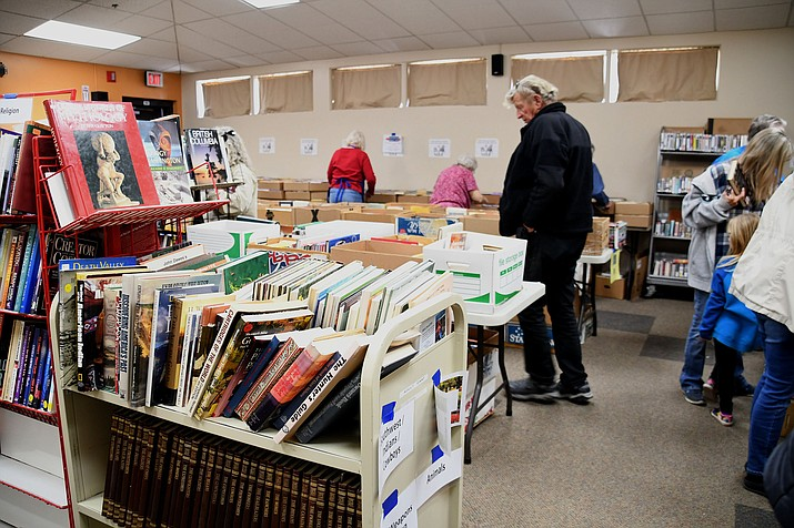 Friends of the Library host book sales in the Mohave County Library – Kingman program room every quarter. This year it decided to bring every book it has to the fairgrounds for a gigantic Spring book sale. (Photos by Vanessa Espinoza/Daily Miner)