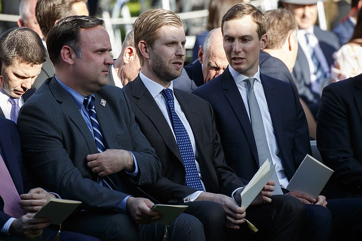 White House Social Media Director Dan Scavino, left, Eric Trump, center, and White House senior adviser Jared Kushner wait for the arrival of President Donald Trump to present golfer Tiger Woods with the Presidential Medal of Freedom, in the Rose Garden of the White House, Monday, May 6, 2019, in Washington. (Evan Vucci/AP)