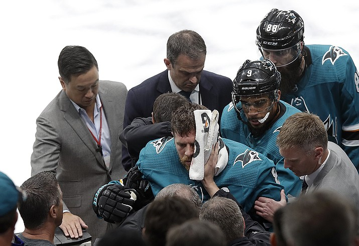 San Jose Sharks center Joe Pavelski, bottom center, is helped off the ice during the third period of Game 7 of an NHL hockey first-round playoff series against the Vegas Golden Knights in San Jose, Calif., Tuesday, April 23, 2019. (Jeff Chiu/AP, file)