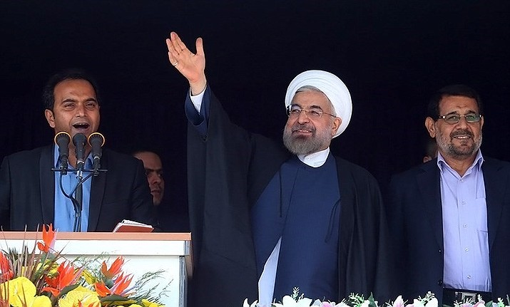 President Hassan Rouhani speaks at Bandar Abbas Stadium in 2014. Rouhani said Wednesday that it will begin keeping its excess uranium and heavy water from its nuclear program, setting a 60-day deadline for new terms to its nuclear deal with world powers before it will resume higher uranium enrichment. (Tasnim News Agency photo, cc-by-sa-4.0, https://bit.ly/2WAVcDy)