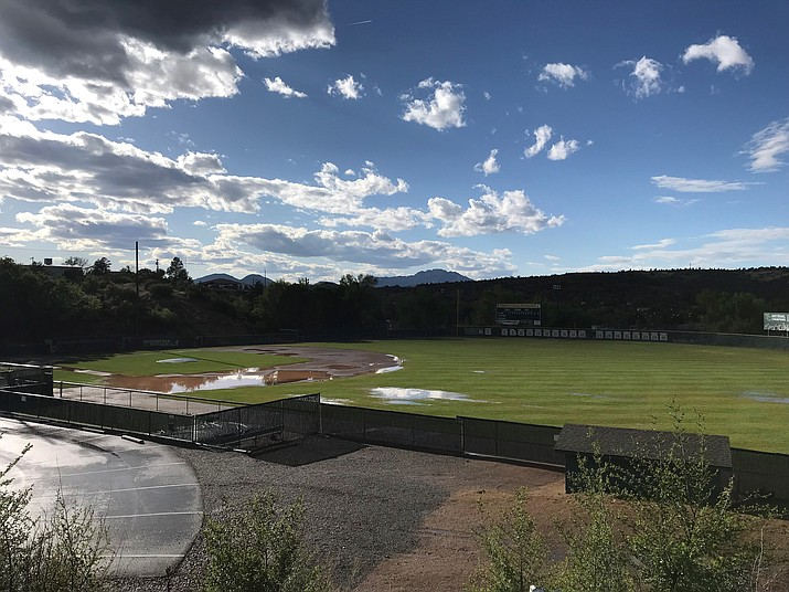 Much of the playing surface at Roughrider Park in Prescott sits under water Wednesday, May 8, 2019, as local storms force the NJCAA Region I Playoff finals to be relocated to Phoenix. The best-of-three finals series between Yavapai College and Central Arizona begins Thursday, May 9, at Paradise Valley Community College in Phoenix. (Brad Clifford/Courtesy)