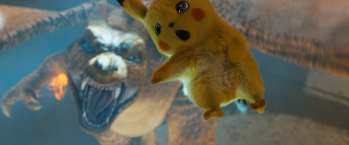 """This image released by Warner Bros. Pictures shows the character Detective Pikachu, voiced by Ryan Reynolds, in a scene from """"Pokemon Detective Pikachu."""" (Warner Bros. Pictures via AP)"""