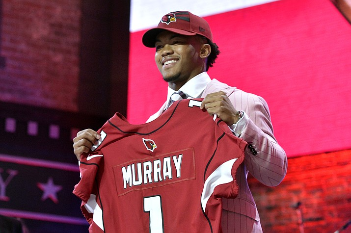 Oklahoma quarterback Kyler Murray holds his up a jersey after the Arizona Cardinals selected Murray in the first round at the NFL football draft, Thursday, April 25, 2019, in Nashville, Tenn. (Brandon Dill/AP, file)