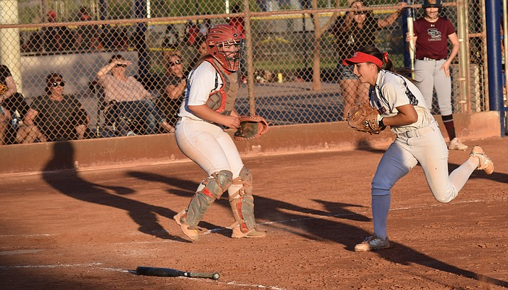 Mingus senior Lacey Saravo catches a pop up during the Marauders' 10-0 loss to Salpointe Catholic in the state tournament on Tuesday in Phoenix. VVN/James Kelley