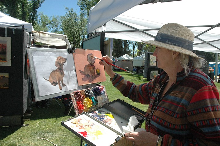 Kathy Wadsworth paints a portrait of a dog. (Jason Wheeler/Courier, file)