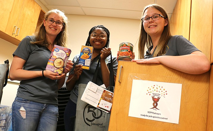 I Am YC Club members display the types of food items available to food insecure students at the YC Verde Valley campus thanks to a new campus food pantry.
