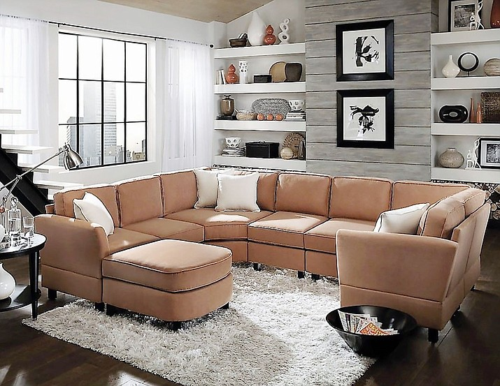 Furnishing your new home should center around a sofa, preferably a sectional, which will also make your home feel fuller — and cozier. (Pinterest/Courtesy)