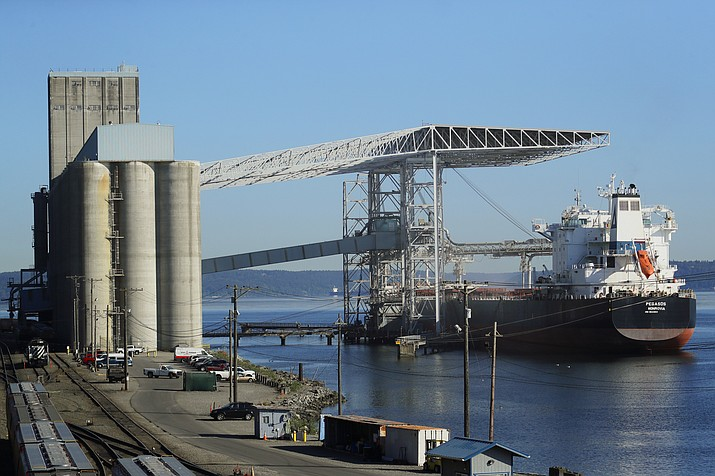 A bulk carrier ship is loaded, Friday, May 10, 2019, at the Temco grain terminal at the Port of Tacoma in Tacoma, Wash. U.S. and Chinese negotiators resumed trade talks Friday under increasing pressure after President Donald Trump raised tariffs on $200 billion in Chinese goods and Beijing promised to retaliate. (Ted S. Warren/AP)