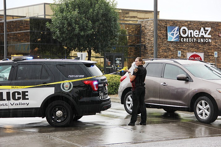 Police block off all entrances and exits to the OneAZ Credit Union in Prescott Valley on Friday, July 13, 2018, following a report of a robbery. (Max Efrein/Courier file)