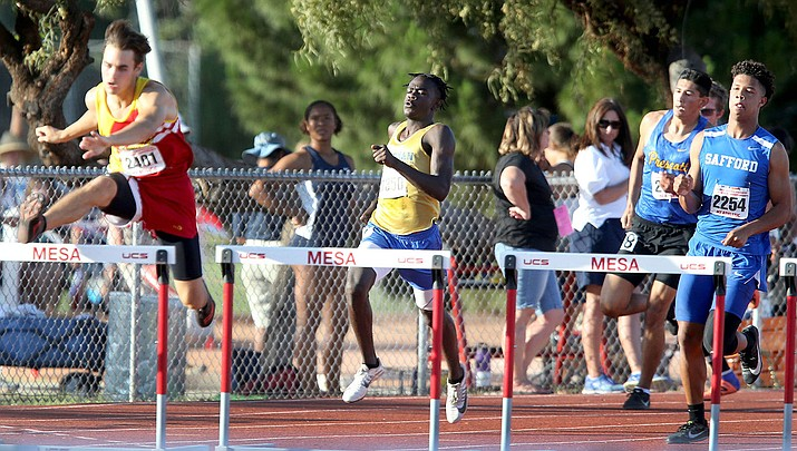 Kingman High's Jamal Cash tallied a pair of third-place finishes in the 110 and 300 hurdles at the Division III State Track and Field Championship. (Photo courtesy of Oscar Perez/Pinal Central)