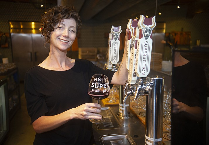 Kim Powers, general manager, at Superstition Meadery in the Old Capitol Market building on Gurley Street in Prescott. (Les Stukenberg/Courier)