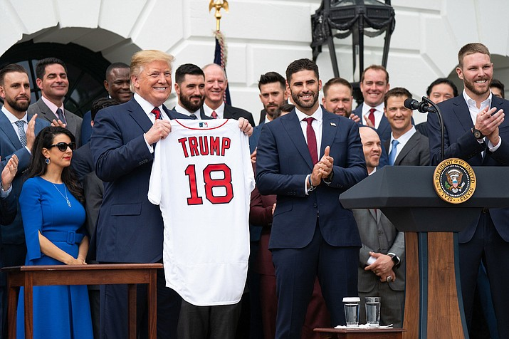 President Donald Trump welcomes the 2018 World Series Champion Boston Red Sox baseball team Thursday, May 9, 2019 at ceremonies on the South Portico entrance of the White House. Trump's combative approach to trade has been one of the main constants among his often-shifting political views. (Official White House Photo by Shealah Craighead)