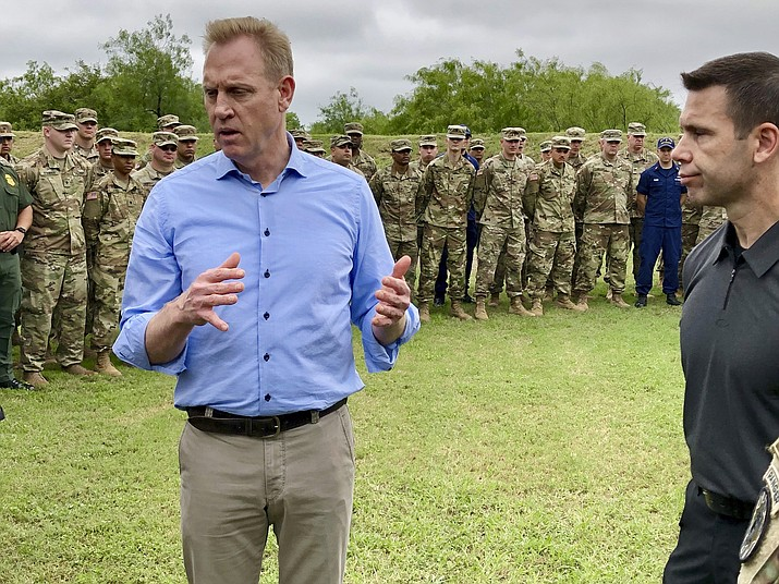 Acting Defense Secretary Patrick Shanahan, left, speaks with troops near McAllen, Texas, about the military s role in support of the Department of Homeland Security s effort to secure the Southwest border. At right is Kevin McAleenan, acting DHS secretary. (Robert Burns/AP)