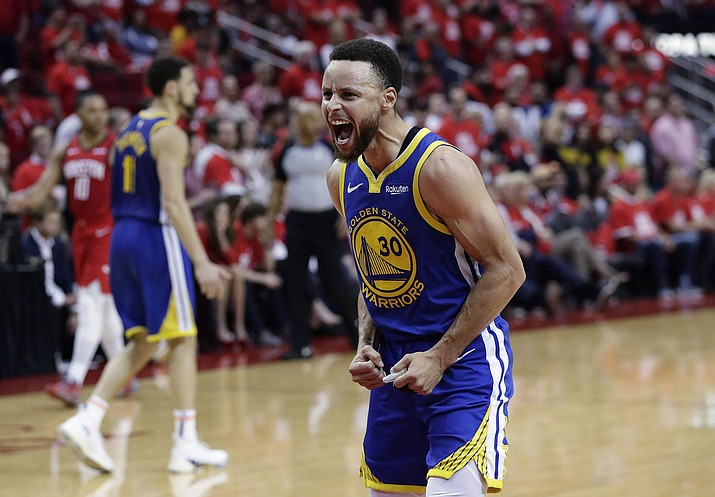 Golden State Warriors guard Stephen Curry celebrates the team's win over Houston in Game 6 of a second-round playoff series, Friday, May 10, 2019, in Houston. Golden State won 118-113, winning the series. (Eric Gay/AP)