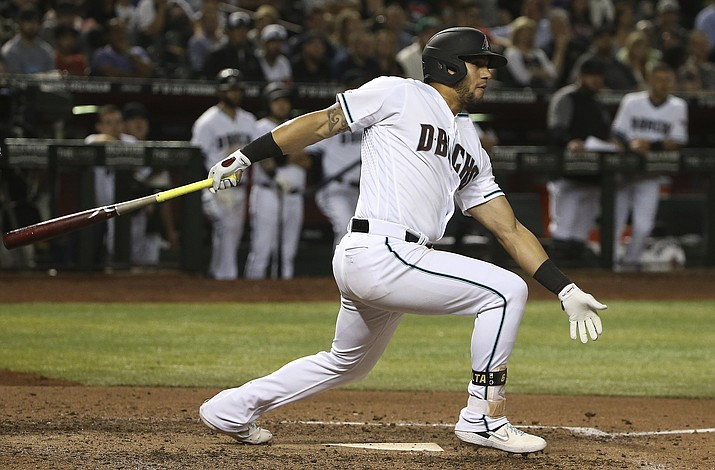 Arizona Diamondbacks' David Peralta watches his RBI triple against the Atlanta Braves during the sixth inning Friday, May 10, 2019, in Phoenix. (Ross D. Franklin/AP)