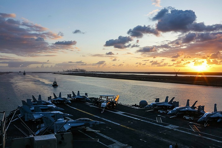 Thursday, May 9, 2019 photo released by the U.S. Navy, the Nimitz-class aircraft carrier USS Abraham Lincoln transits the Suez Canal in Egypt. The aircraft carrier and its strike group are deploying to the Persian Gulf on orders from the White House to respond to an unspecified threat from Iran. (Mass Communication Specialist Seaman Dan Snow, U.S. Navy via AP)