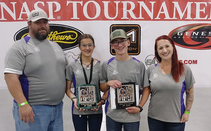 Heritage Middle School Coach Brian James and Megan Yakovoch with Anna Lowman and Luke McLaughlin at the National Archery in the Schools program's Western National Tournament in Salt Lake City. Lowman took fifth in the middle school girls division and McLaughlin took third in the middle school boys division. (Jen Lowman/Courtesy)