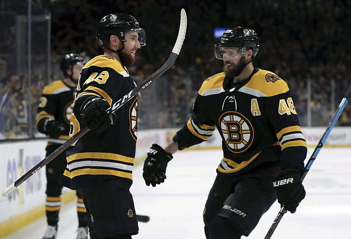 Boston Bruins' Matt Grzelcyk, left, celebrates his goal against the Carolina Hurricanes with David Krejci during the second period in Game 2 of the NHL Stanley Cup Eastern Conference final series, Sunday, May 12, 2019, in Boston. (Charles Krupa/AP)