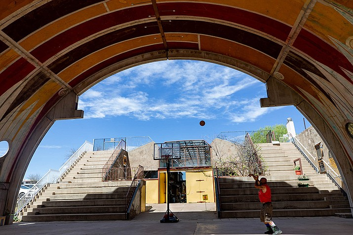 A resident shoots baskets in the vaults, which are a community area in Arcosanti, welcome to residents and visitors alike. (Meg Potter/Cronkite News)