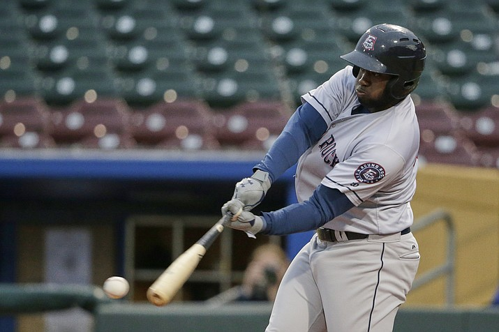In this May 7, 2019 photo, Round Rock designated hitter Yordan Alvarez, who leads the Triple A league with 13 home runs, swings at a pitch in Papillion Neb. Triple-A baseball is seeing a dramatic increase in home runs with the major league ball being used for the first time at the highest level of the minor leagues. Alvarez now shares the Triple-A lead with 14 homers. (Nati Harnik/AP, file)