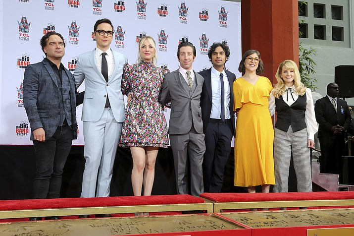 "Johnny Galecki, from left, Jim Parsons, Kaley Cuoco, Simon Helberg, Kunal Nayyar, Mayim Bialik and Melissa Rauch, cast members of the TV series ""The Big Bang Theory,"" pose at a hand and footprint ceremony at the TCL Chinese Theatre on Wednesday, May 1, 2019 at in Los Angeles. (Willy Sanjuan/Invision/AP)"