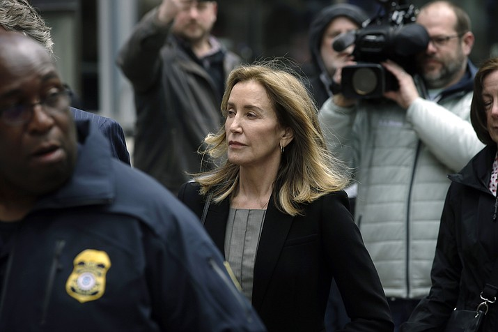 Felicity Huffman arrives at federal court Monday, May 13, 2019, in Boston, where she is scheduled to plead guilty to charges in a nationwide college admissions bribery scandal. (Steven Senne/AP)