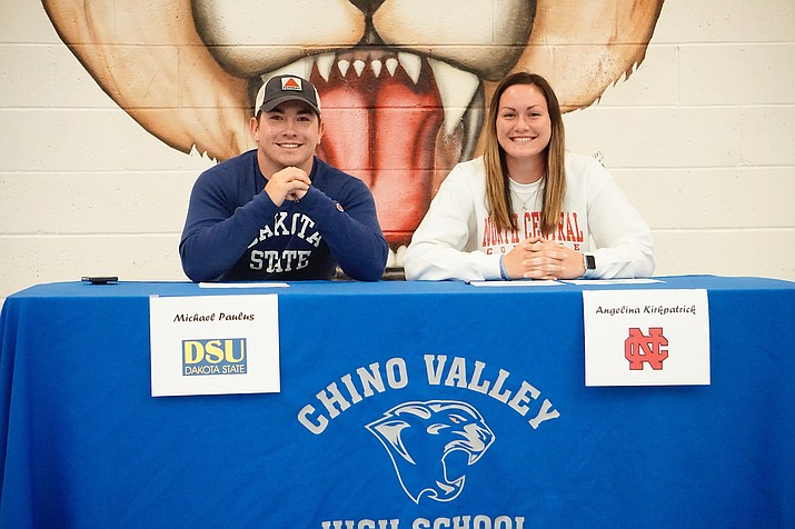 Chino Valley's Michael Paulus Jr., right, and Angelina Kirkpatrick sign their letters of intent during Signing Day on Monday, May 13, at Chino Valley High School to continue their athletic careers at Dakota State University and North Central College, respectively. (Aaron Valdez/Courier)