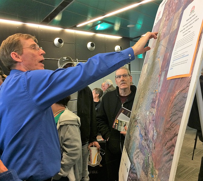Area residents turned out to view evacuation maps on display during the Prescott Valley open house May 7 in the Prescott Valley Public Library. (Sue Tone/Tribune)