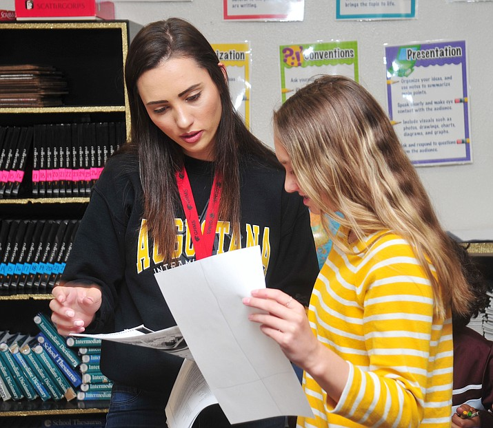 Katelyn Johnson works with 7th grader Ashlynn Sabo in her 7th and 8th grade Creative Writing class at Glassford Hill Middle School in Prescott Valley Wednesday, May 8.   (Les Stukenberg/Prescott News Network)