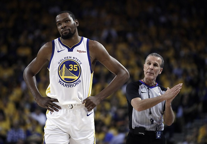 Golden State Warriors' Kevin Durant, left, walks away from referee Ken Mauer during the first half of Game 5 of the team's second-round NBA playoff series against the Houston Rockets on Wednesday, May 8, 2019, in Oakland, Calif. (Ben Margot/AP)