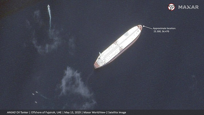 "This satellite image provided by Maxar Technologies shows the Saudi-flagged oil tanker Amjad off the coast of Fujairah, United Arab Emirates, Monday, May 13, 2019. As many as four oil tankers anchored in the Mideast were damaged in what Gulf officials described Monday as a ""sabotage"" attack off the coast of the United Arab Emirates. (Satellite image 2019 Maxar Technologies via AP)"