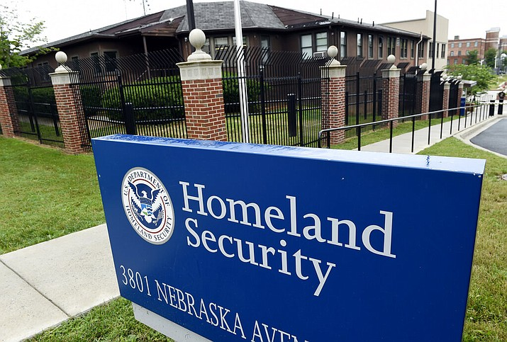 This 2015, file photo, shows the Homeland Security Department headquarters in northwest Washington. Homeland Security officials considered arresting migrant families around the country who had final deportation orders and removing them from the U.S. in a flashy show of force, according to two Homeland Security officials and two people familiar with the proposal. (AP Photo/Susan Walsh, File)