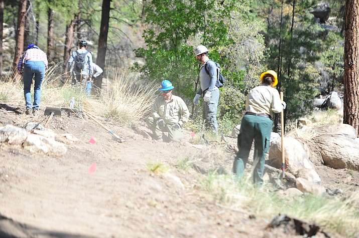 Prescott National Forest Trails and Wilderness Manager Jason WIlliams helps a group as more than 50 volunteers came out to the Spence Basin trail system to help the Prescott National Forest as part of National Trails Day on Saturday, May 19, 2018, in Prescott. (Les Stukenberg/Courier file)