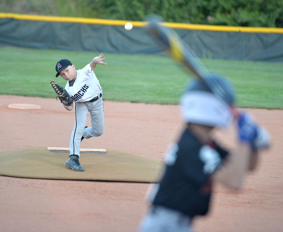 Trace Overton delivers a pitch during the Prescott Little League majors City Championship semi-final game Tuesday, May 14.  (Les Stukenberg/Courier)