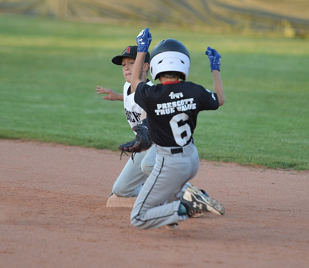 Taylor Keppel tries to make the tag on Caden Bernier during the Prescott Little League majors City Championship semi-final game Tuesday, May 14.  (Les Stukenberg/Courier)
