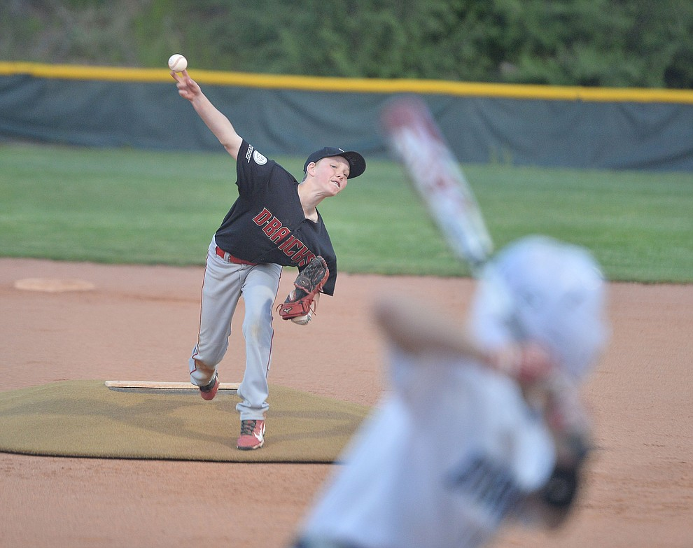 Adrian Sanderford delivers a pitch during the Prescott Little League majors City Championship semi-final game Tuesday, May 14.  (Les Stukenberg/Courier)