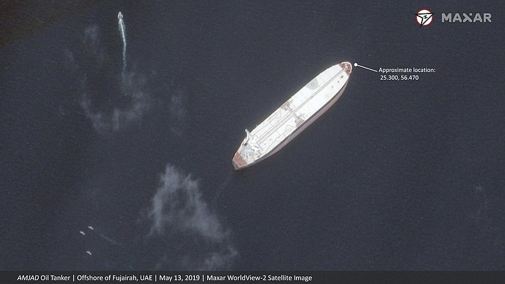 "This satellite image provided by Maxar Technologies shows the Saudi-flagged oil tanker Al Marzoqa off the coast of Fujairah, United Arab Emirates, Monday, May 13, 2019. As many as four oil tankers anchored in the Mideast were damaged in what Gulf officials described Monday as a ""sabotage"" attack off the coast of the United Arab Emirates. (Satellite image ©2019 Maxar Technologies)"