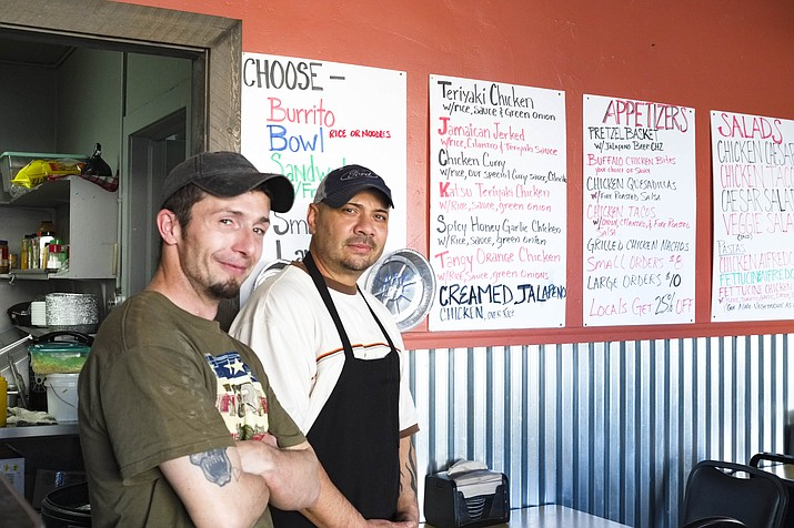 Little Chicken Spot owner Rick Gonzalez (right) and chef James Wright offer chicken based dishes six days a week in Williams. (Loretta Yerian/WGCN)