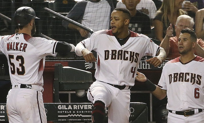 Arizona D-backs first baseman Christian Walker (53) celebrates his home run against Pittsburgh with teammates Ketel Marte (4) and David Peralta (6) during the seventh inning of a game, Monday, May 13, 2019, in Phoenix. (Ross D. Franklin/AP)