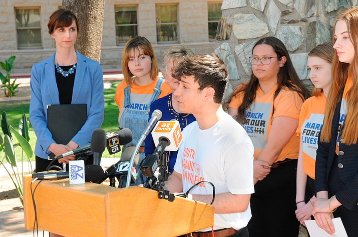 Jordan Harb of the March for Our Lives movement speaks Monday as state superintendent of public instruction Kathy Hoffman, far left, listens. (Howard Fischer/Capitol Media Services)