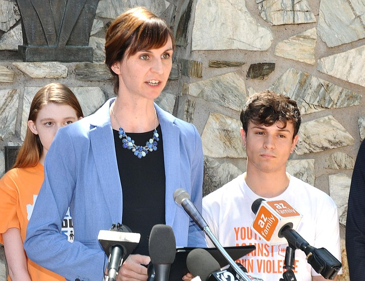 State schools chief Kathy Hoffman outlines the scope of a safety task force on Monday her agency is launching. Hoffman said she wants to hear from all sides, including the March for Our Lives group which was organized by Mesa high school senior Jordan Harb, to her left. (Capitol Media Services photo by Howard Fischer)