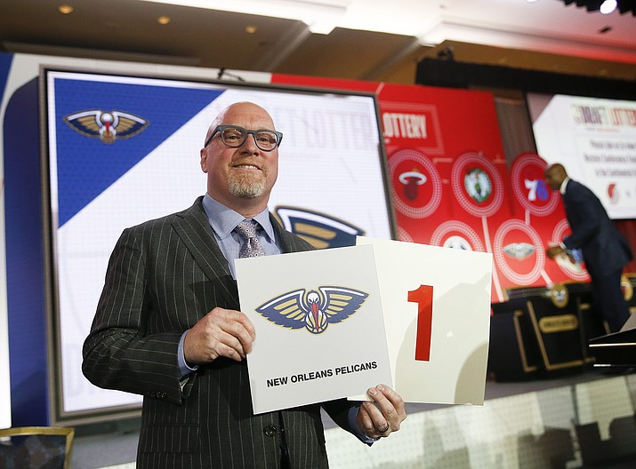 David Griffin, New Orleans Pelicans executive vice president of basketball operations, holds up placards after it was announced that the Pelicans had won the first pick during the NBA basketball draft lottery Tuesday, May 14, 2019, in Chicago. (Nuccio DiNuzzo/AP)