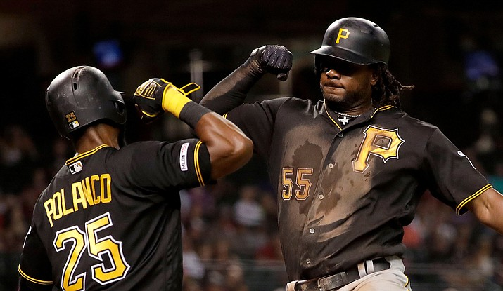 Pittsburgh Pirates' Josh Bell celebrates his two-run home run with Gregory Polanco (25), during the fifth inning of the team's game against the Arizona Diamondbacks on Tuesday, May 14, 2019, in Phoenix. (Matt York/AP)