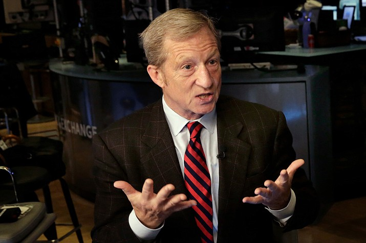 """California billionaire Tom Steyer prepared to pump more cash into the Arizona to """"educate"""" voters about what Steyer's political action committee believes is the outsize influence that Arizona Public Service has on state politics.  (Richard Drew/AP, file)"""