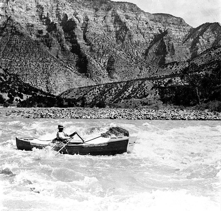 Nathaniel Galloway running a rapid below Split Mountain during the 1909 Stone Expedition along the Colorado River. (Raymond Cogswell via NPS)