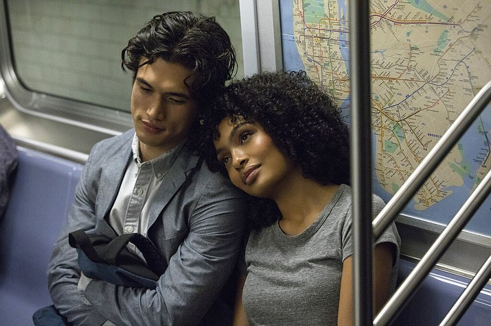 In this image released by Warner Bros. Pictures, Charles Melton, left, and Yara Shahidi appear in a scene from the film The Sun Is Also a Star. (Atsushi Nishijima/Warner Bros. Pictures via AP