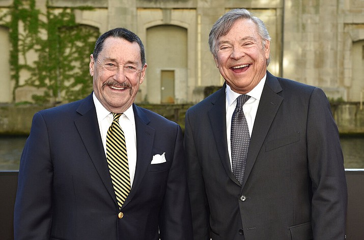 "In this Tuesday, June 20, 2017 file photo, Peter Cullen, left, and Frank Welker pose for a photo at the U.S. premiere of ""Transformers: The Last Knight"" at the Civic Opera House in Chicago. Cullen and Welker could be heard in children's homes across the United States starting in the fall of 1984 as the heroic Optimus Prime and villainous Megatron respectively. (Photo by Rob Grabowski/Invision/AP, File)"