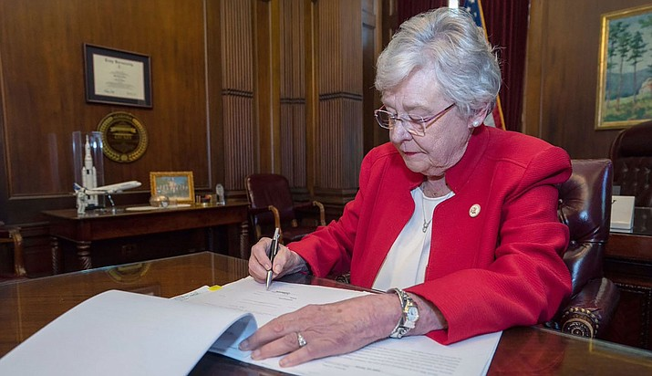 Gov. Kay Ivey signs a law that makes performing an abortion at any state of pregnancy a felony punishable by 10-99 years or life in prison for the provider. (Alabama Governor's Office photo)